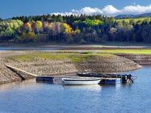Small boats and shore of Liptovska Mara Lake royalty free stock photos