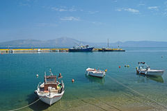 Small boats in sunny Greek harbour. Small boats in harbour on island of Evia, Greece Royalty Free Stock Image