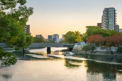 Small boats at sunset on Motoyasu river in Hiroshima, Japan. royalty free stock photo