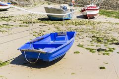 Small boats suspended on the ship in the smallest port of France, Port Racine, Cotentin peninsula. PORT RACINE, CHERBOURG, NORMANDY, FRANCE - JUNE CIRCA, 2018 royalty free stock photography