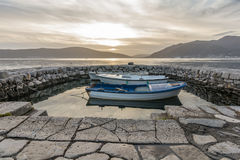 Small boats tied in little marina of Tivat harbor Stock Images