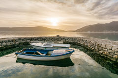 Small boats tied in little marina of Tivat harbor Stock Photography