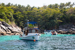 Small boats with tourists of the island of Phi Phi, Andaman Sea, Stock Photo