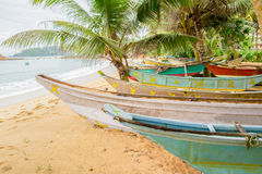 Small boats on tropical beach Stock Photography