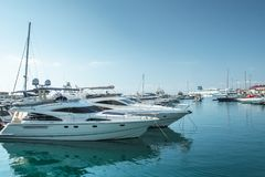 Small boats and yachts are in the berth of the seaport of Sochi stock photos