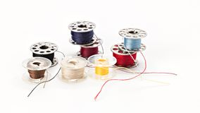 Small bobbins of thread used in a sewing machine Royalty Free Stock Images