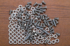Small bolts and nuts Royalty Free Stock Photo