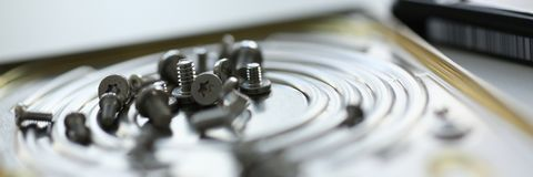 Small bolts removed macro in repair shop to restore. Micro engineering background Royalty Free Stock Image