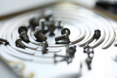 Small bolts removed macro in repair shop to restore. Micro engineering background Royalty Free Stock Photography