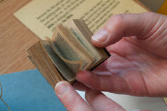 Small book. Hands holding a tiny book Royalty Free Stock Images