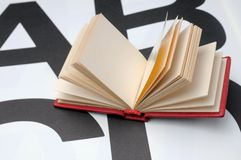 Small book. On the large letters Royalty Free Stock Images