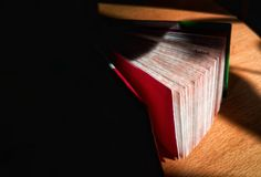 Small book is opening. A small book for entries. In a dark room. For notes Stock Images