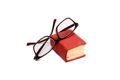 Small book and glasses. Pocket dictionary book and glasses isolated over white background Royalty Free Stock Photos