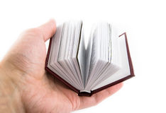 Small book in a hand. On a white background Stock Photo