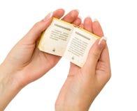 Small book in his hands. Small book in his hand to isolate white background Stock Image