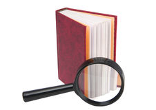 The small book and magnifier. On a white background Royalty Free Stock Images
