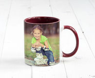 Small bordeaux cup with dark red handle Royalty Free Stock Photos