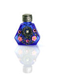 Small bottle for aromas. The small bottle decorated with a flower ornament Royalty Free Stock Image