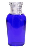 Small bottle with blue liquid on white background Stock Photo