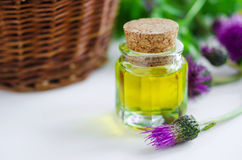 Small bottle of burdock oil Stock Photos