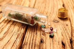 Small bottle and glass shards Royalty Free Stock Images
