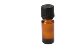 A small bottle of oil. A small isolated bottle of oil Royalty Free Stock Photos