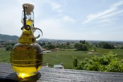 Small bottle of Olive Oil. Sky donates a small bottle of italian Olive Oil Stock Image