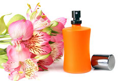 Small bottle with a perfume liquid and flowers Stock Photo