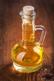 Small bottle with sunflower oil on old wooden board Royalty Free Stock Photos