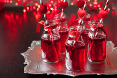 Small bottles with cranberry cocktail Stock Photo