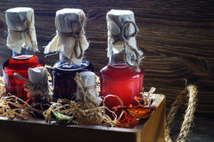 Small bottles of liquor in a wooden box. Small bottles of liquor in a wooden box on a wooden background. Small bottle with alcohol Stock Photography
