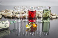 Small bottles with pills along with a syringe Stock Images