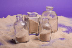 Small bottles with sand Stock Images