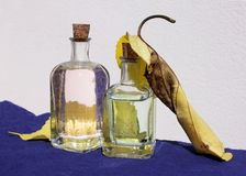 Small Bottles and Yellow Leaves Royalty Free Stock Image