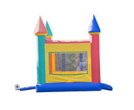 Small bounce castle. Small castle shaped bounce house isolated on white Stock Photos