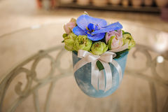 Small bouquet of flowers  with blue orchid Royalty Free Stock Photo