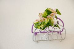 A small bouquet of flowers, on the napkin stand royalty free stock image