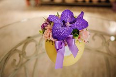 Small bouquet of flowers  with purple orchid Royalty Free Stock Photos