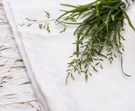 Small bouquet of grass on white textile Royalty Free Stock Photo