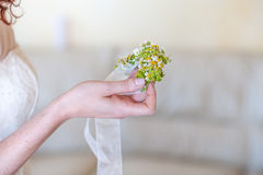 Small bouquet with hands Stock Image