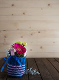 Small bouquet in knitted vase Stock Images