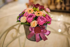 Small bouquet of pink and purple flowers  in box Royalty Free Stock Photo