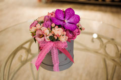 Small bouquet of pink and purple flowers  in box Royalty Free Stock Image