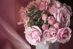 A small bouquet of pink roses. Wedding floristry.Delicate pastel colors. A small bouquet of pink roses. Wedding floristry. Delicate pastel colors royalty free stock images
