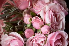 A small bouquet of pink roses. Wedding floristry.Delicate pastel colors. Texture. A small bouquet of pink roses. Wedding floristry. Delicate pastel colors stock photography