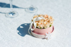 Small bouquet of pink roses for wedding rings Royalty Free Stock Photo