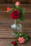 Small bouquet of roses on a wooden background Royalty Free Stock Photo