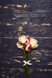 Small bouquet of spray roses, flat lay shot. Top view of small bouquet of spray roses. Flat lay shot. Bunch of roses isolated on grunge background Royalty Free Stock Image