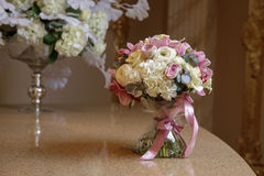 Small bouquet on the table. With red and white flowers Stock Images