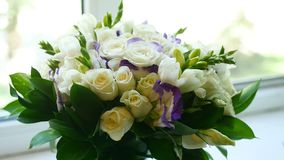 Small bouquet of white roses on the video window. Small bouquet of white roses on video window stock video